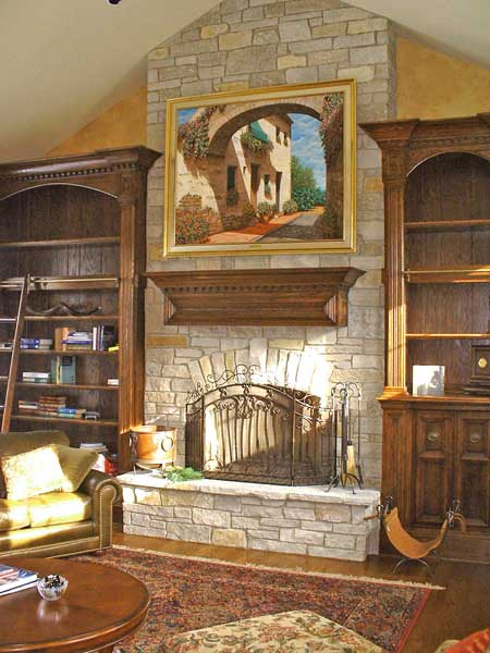 Old World Style Mantle with Flanking Bookcases